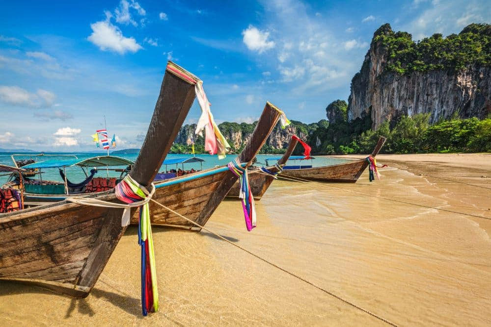 Long tail boats on tropical beach Railay beach in Thailand
